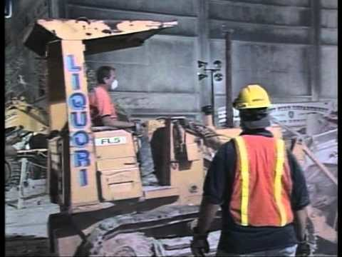 Ground Zero, New York on 9/11, night – bulldozing dust